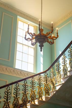 Georgian Stairway with chandelier hanging from  ceiling